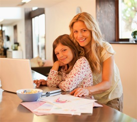 Mom and daughter by laptop
