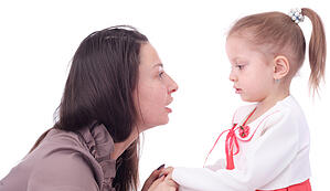 mom talking to daughter